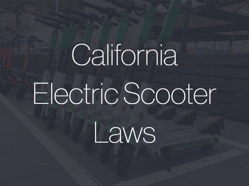 "A line of electric scooters on a sidewalk with the text ""California Electric Scooter Laws"" superimposed"