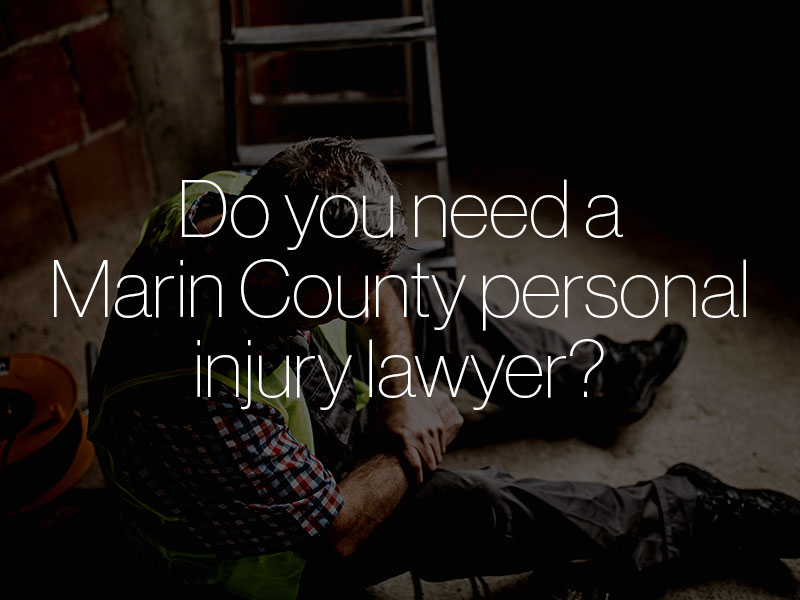 "An injured construction worker clutching his wrist with the text ""Do you need a Marin County personal injury lawyer?"" superimposed"