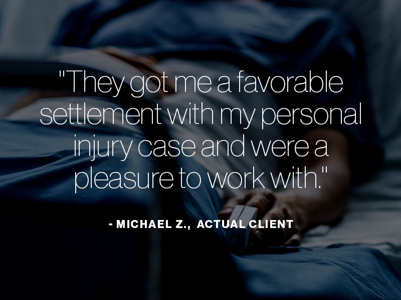 "A man laying in a hospital bed with the text ""They got me a favorable settlement with my personal injury case and were a pleasure to work with. - Michael Z., actual client"" superimposed"