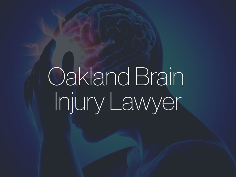 """A CGI graphic of a person holding their head with the text """"Oakland Brain Injury Lawyer"""" superimposed"""