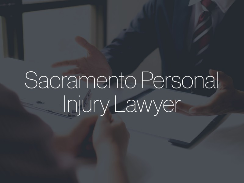 "A lawyer speaking with a client with the text ""Sacramento Personal Injury Lawyer"" superimposed"