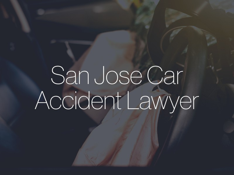 "A car with airbags deployed with the text ""San Jose Car Accident Lawyer"" superimposed"